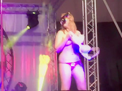 Fat participant girl and her sexy friends dance sensually on the stage
