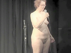 Mature dame delivers a speech while being completely naked
