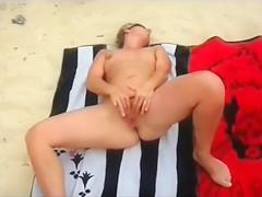 I filmed an irresistible woman jill off on a sandy beach