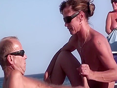 Voyeur catches a hot French wife tugging on a stiff cock