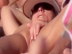 Seductive French nudist spreads her legs and rubs her clit