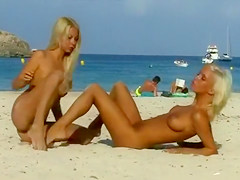 Russian blondes in string bikinis strip on public beach
