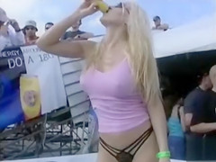 Dancing bikini babes are sexy at an outdoor party