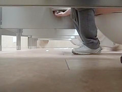 Foot fetish cam in the public lavatory