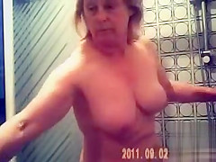Mature mommy cleans up after work in the bathroom
