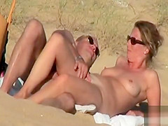 Couple flirts and fondles at the Crimean nude beach