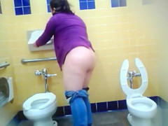 Mature Mexican woman goes pee in a public bathroom