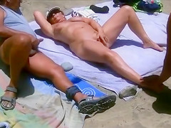 Masturbating to a curvy mature mommy at the nudist beach