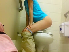 Naughty goddess films her peeing in the public WC