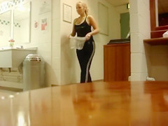 Pretty blonde takes a piss into the nylon bag