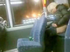 Drunk blonde madam pissing in the back of the bus