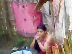 Topless Indian wife washes herself