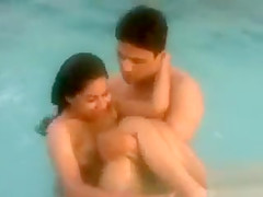 Skinny dipping girl and her man in the pool