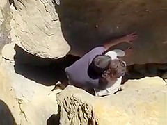 Drilling her twat between the rocks