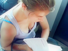 Great cleavage on a chick reading on the train
