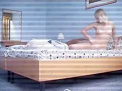 Uninhibited blonde takes her clothes off and goes to bed in