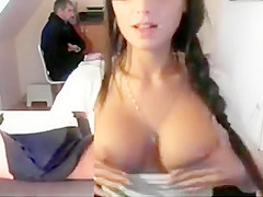 Geeky brunette fondles her sweet tits and erect nipples in