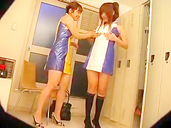 Two naughty Oriental girls change clothes and expose their