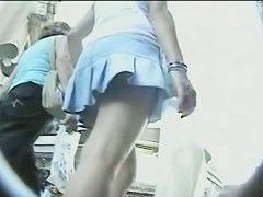 Seductive wind blown up skirt view of girl's white panties