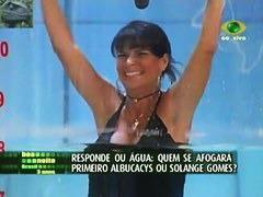 Cute brunette show girl offers hot up skirt on tv