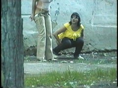 a couple of shameless birds pissing in the street in broad daylight