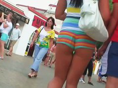 Hot Brunette shows off butt cheek in sexy booty shorts video