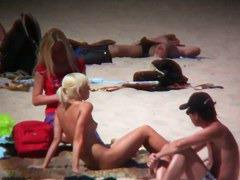 Smoking hot blonde on hidden beach cam