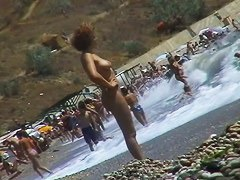 Real beach voyeur video of hot nudist chicks showing off their bodies by the water
