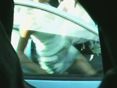 A quick glimpse at a blonde's crotch as she gets in the car