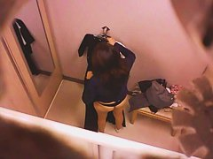 Brunette asian in black thongs changing clothes spy video