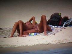 Hot wife flaunts her bushy muff on a nudist beach