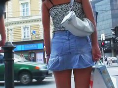 Spy cam porno vid of a brunette babe in a jean skirt walking around
