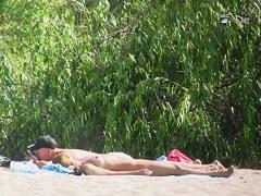 Beach nudist hunter voyeuring nude bodies from behind bushes