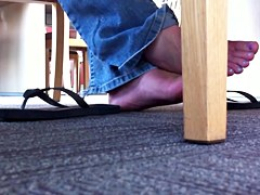 hidden footsie in library,needs time but she likes it