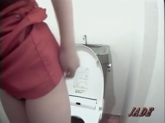 Mature pissing on toilet office
