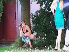 Milf in sunglasses pissing in public on the voyeur cam
