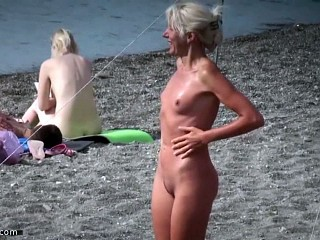 Milf at nude beach flirting
