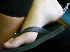 candid blonde tourist feet in flipflops