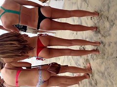 3 teen thongs on beach