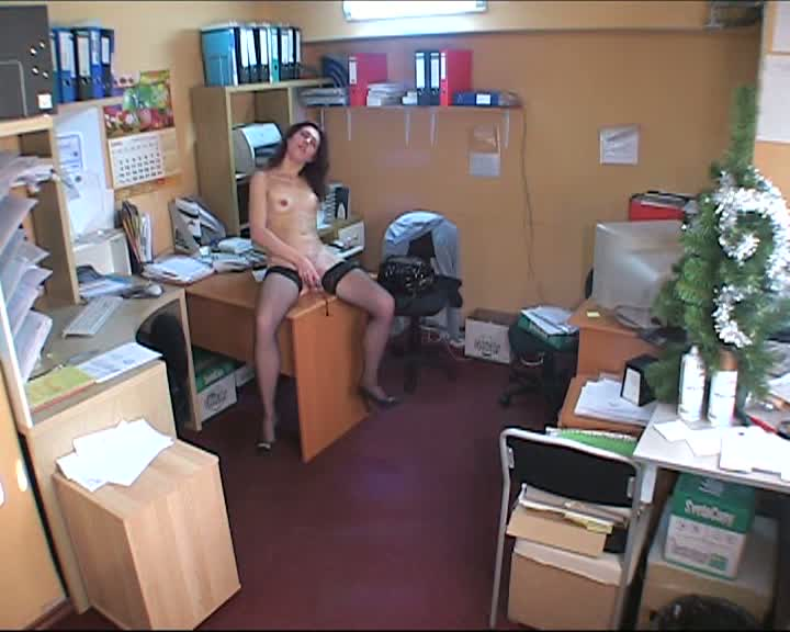 Candid brunette on office table