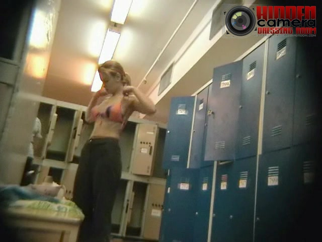Medium sized tits exposed in a dressing room spy video