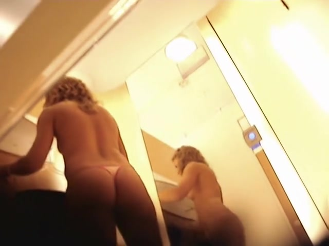 Spy cam girl in dressing room moves nude body erotically
