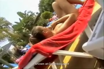 Downblouse oops of the amateur girl at the pool