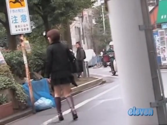 Cute Asian babe gets a skirt sharking on the street.
