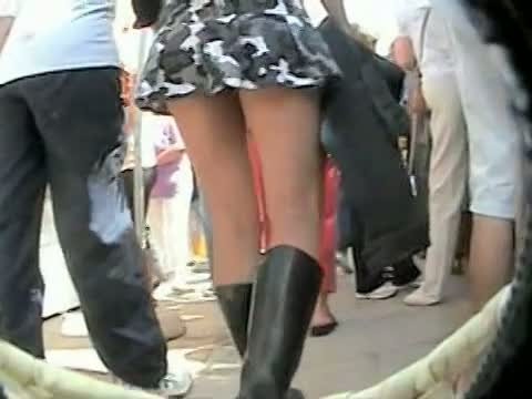Upskirt voyeur video show a yummy booty and a sexy white thong.