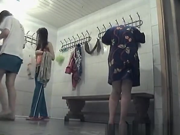 Teens drying and dressing in locker room