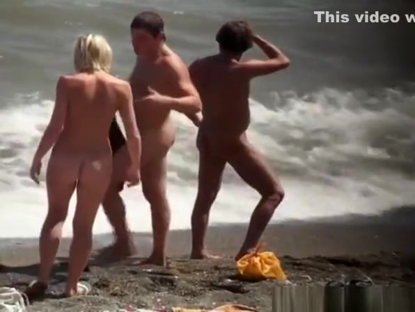 Nudist blonde woman caught in nudist beach