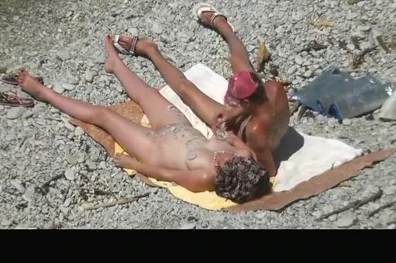 Nude woman grabs man's cock