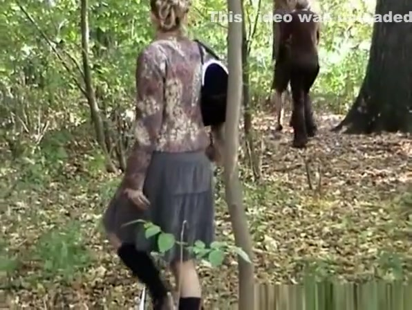 Shy woman in skirt and black boots peeing