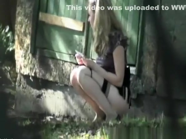 Blonde caught peeing outside